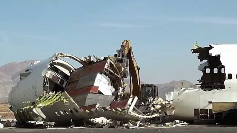 Airliner being crushed into smaller pieces for recycling
