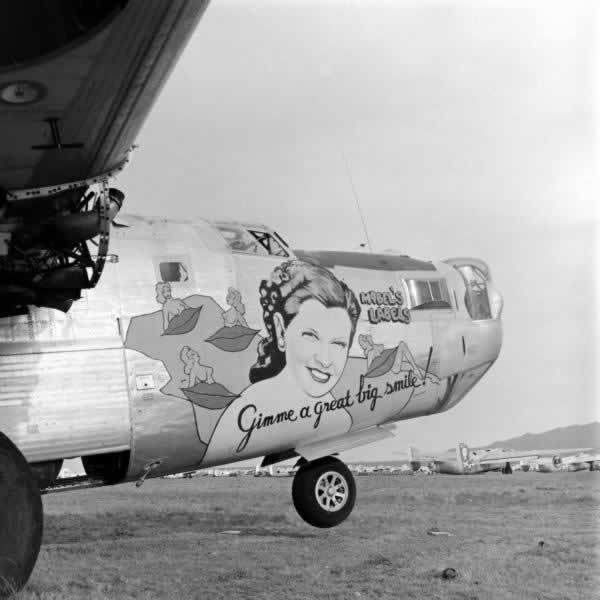 "B-24 Liberator ""Mabel's Labels"" ... ""Gimme a Great Big Smile!"" engines removed and awaiting the smelter"
