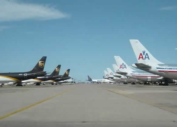 Lines of UPS and American Airlines jets in storage at the Roswell International Air Center