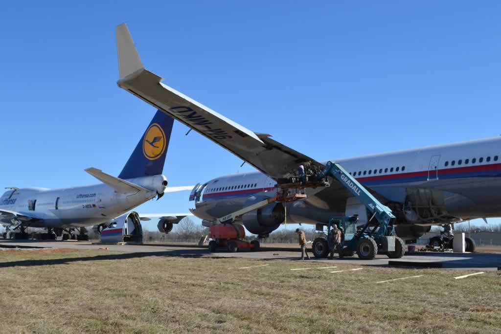 Airliner disassembly at the Tupelo Regional Airport, with Lufthansa Boeing 747 D-ABTA to the left