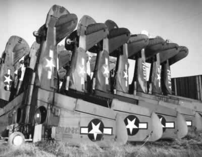 Curtiss P-40 Warhawks stacked on their noses to save space at Walnut Ridge, Arkansas after World War II
